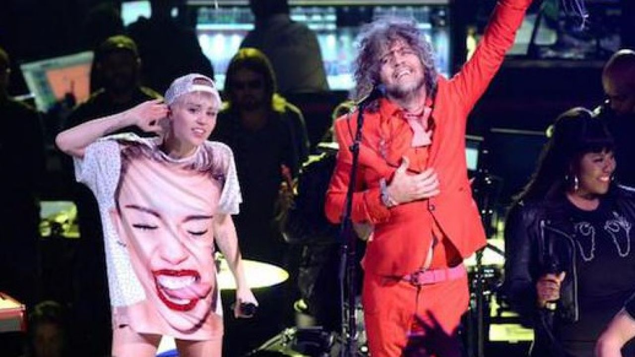 Miley Cyrus and The Flaming Lips perform on SNL, announce