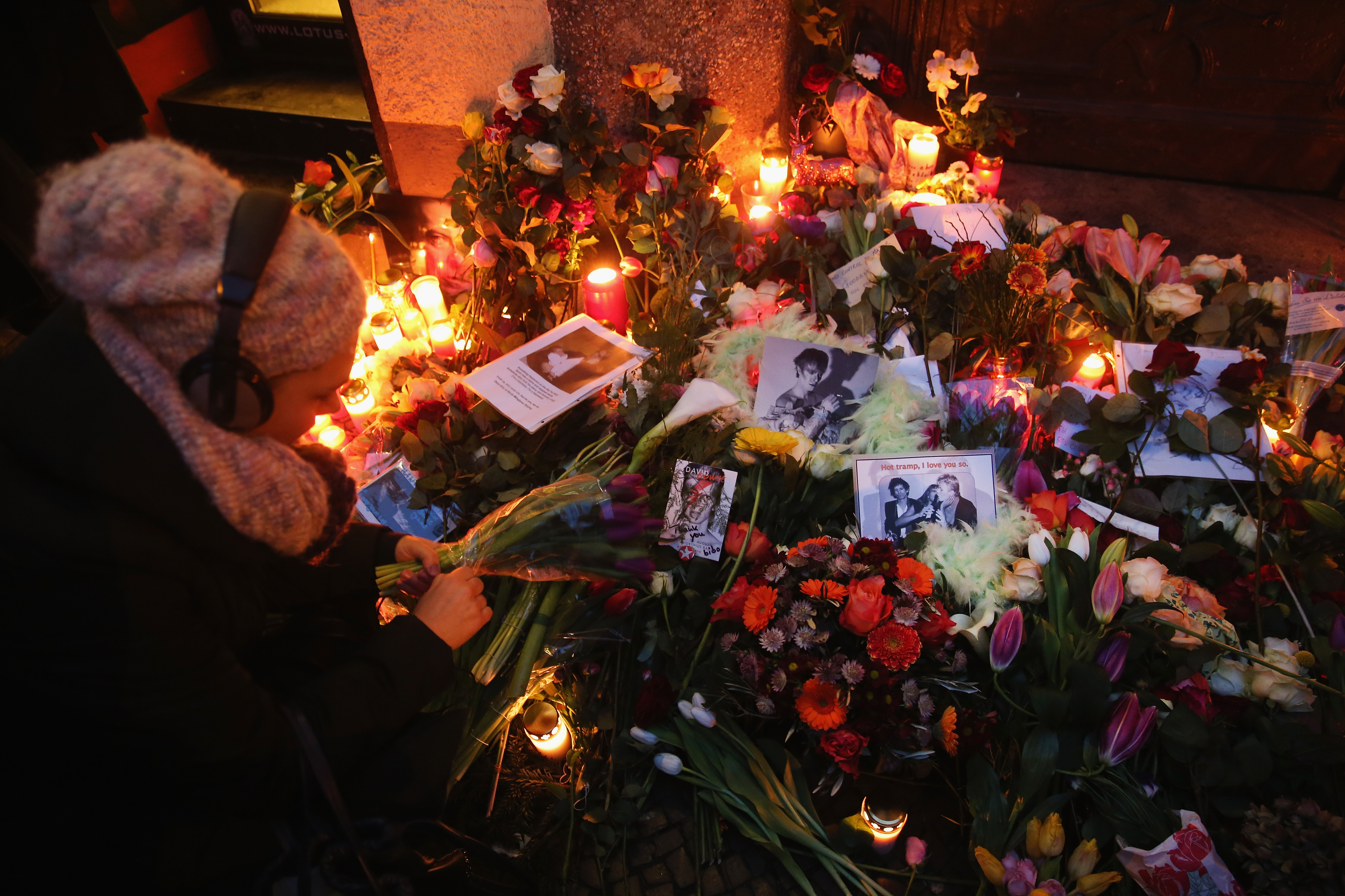 Fans lay flowers and candles at the doorstep where Bowie once lived in Berlin, Germany (Photo: Sean Gallup/Getty Images)