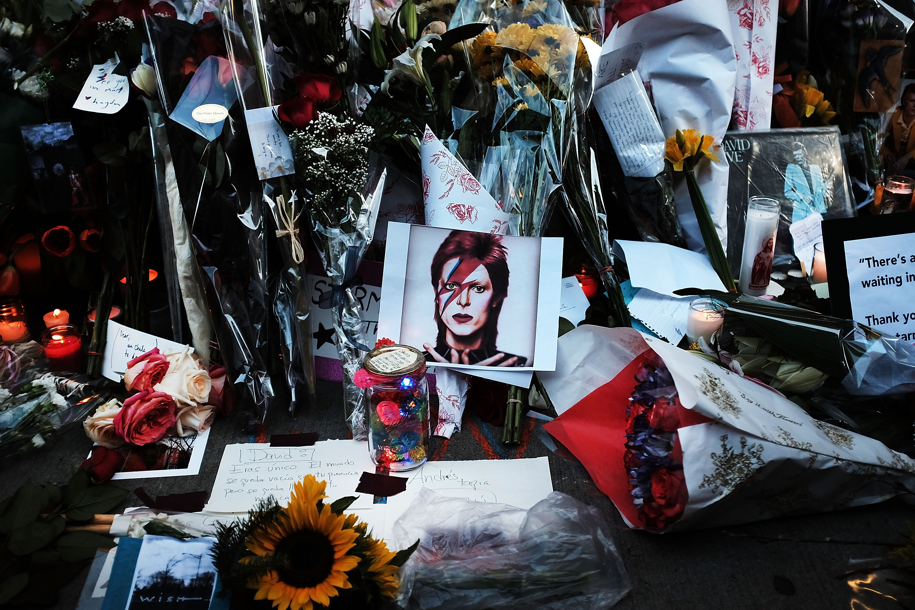 Flowers, candles and pictures sit at a memorial in New York City (Photo: Spencer Platt/Getty Images)