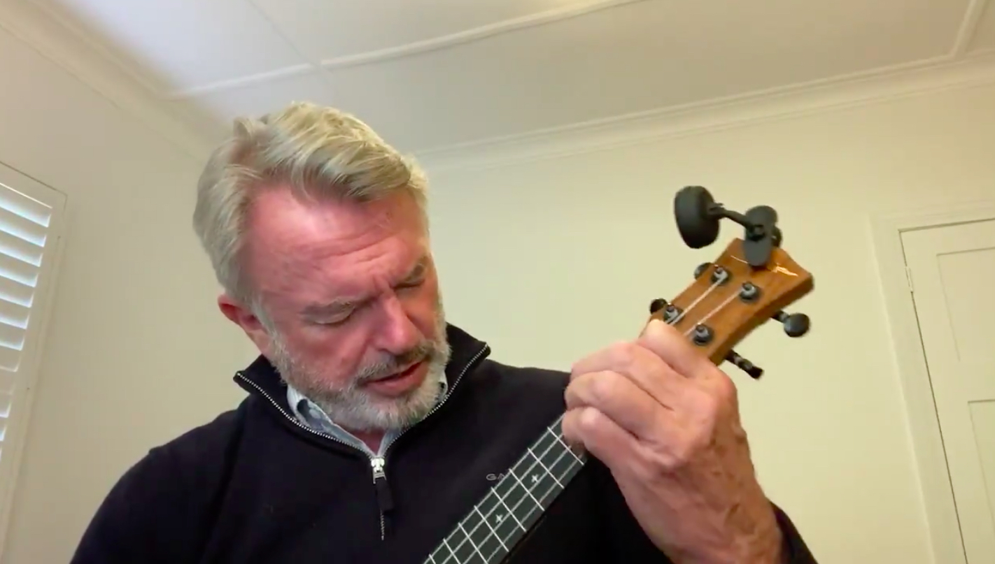 Sam Neill playing 'Uptown Funk' on a ukulele